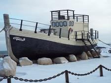 Old fishing boat on display