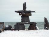 An inunnguaq by the beach