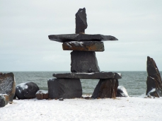 An inunnguaq by the beach