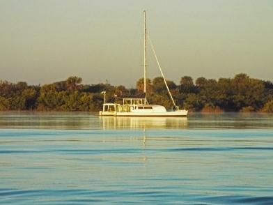 Tranquil sailboat at dawn.