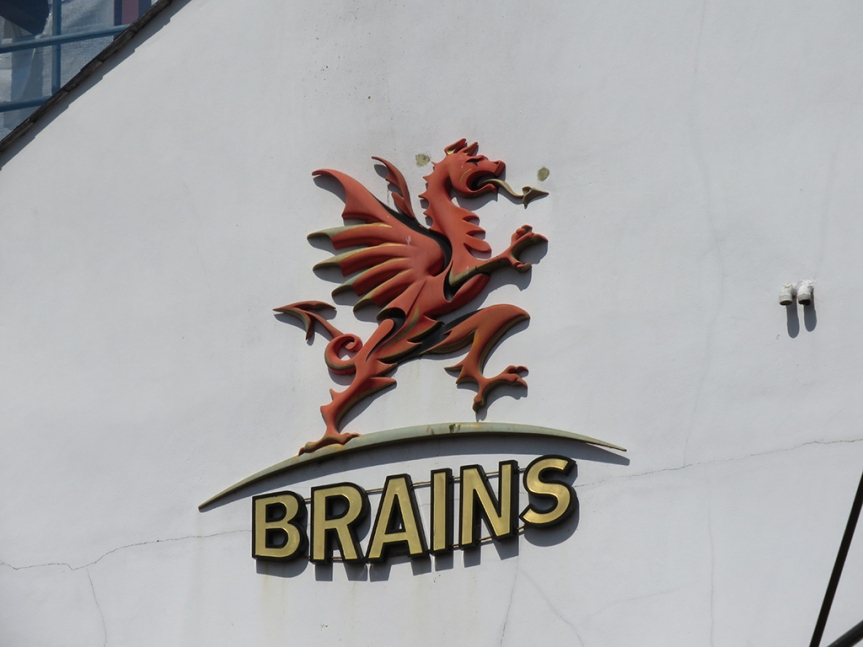 Brains brewery dragon logo on the side of a building.
