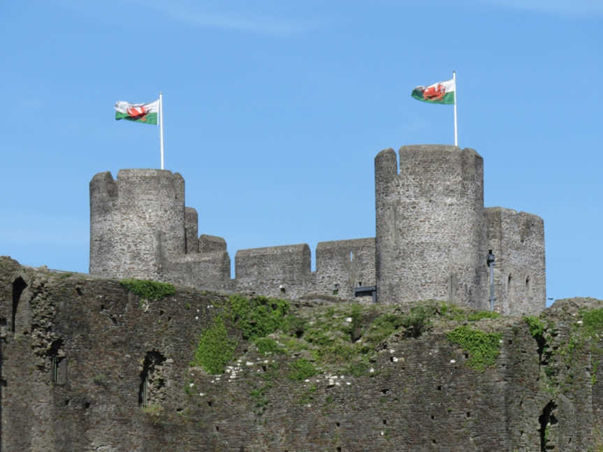 Welsh flags flying over part of Caerphilly Castle