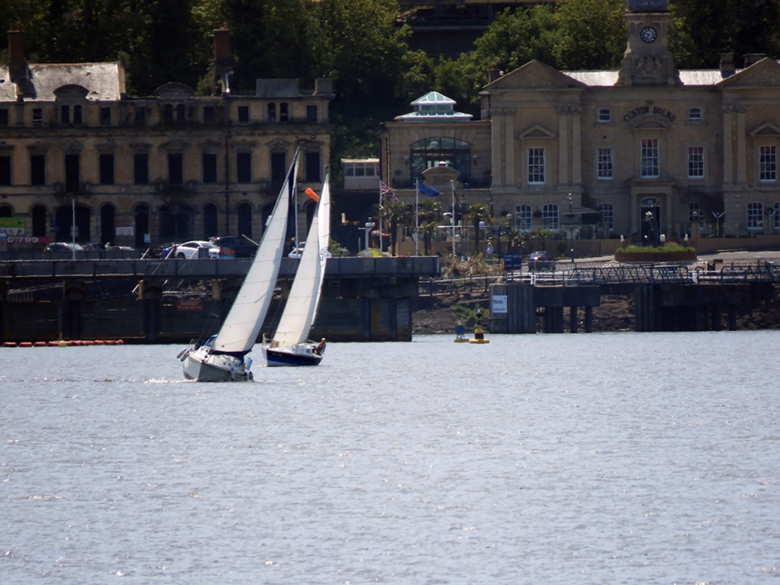 A couple of sailboats out in Cardiff Bay.
