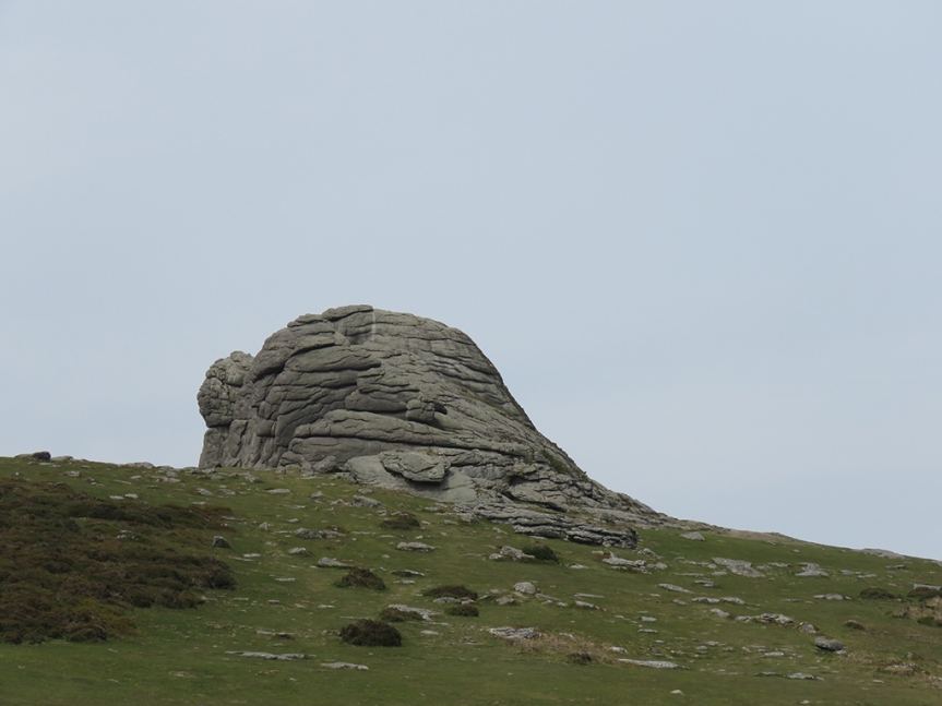 Rocky outcrop with stones scattered below.