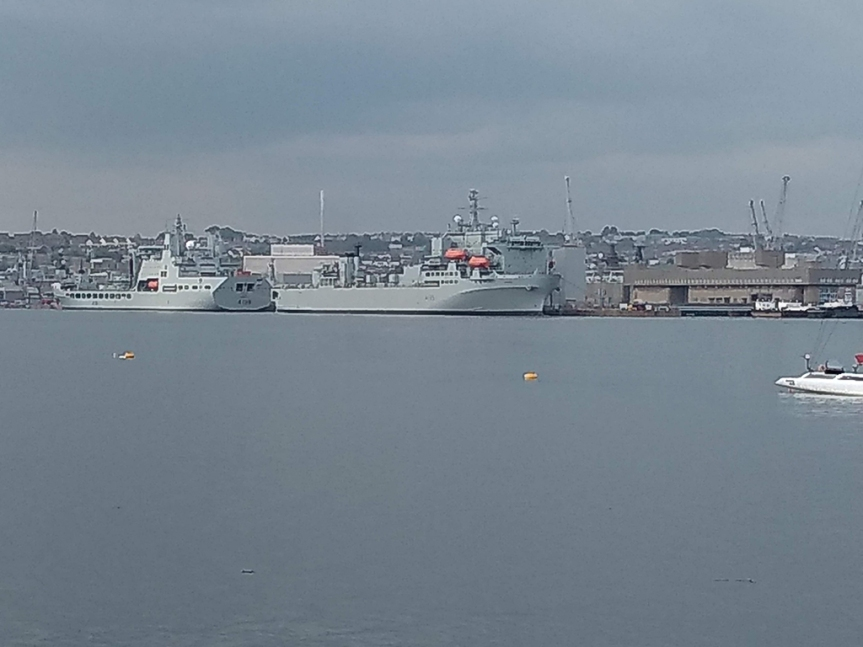 2 naval ships across the harbor.