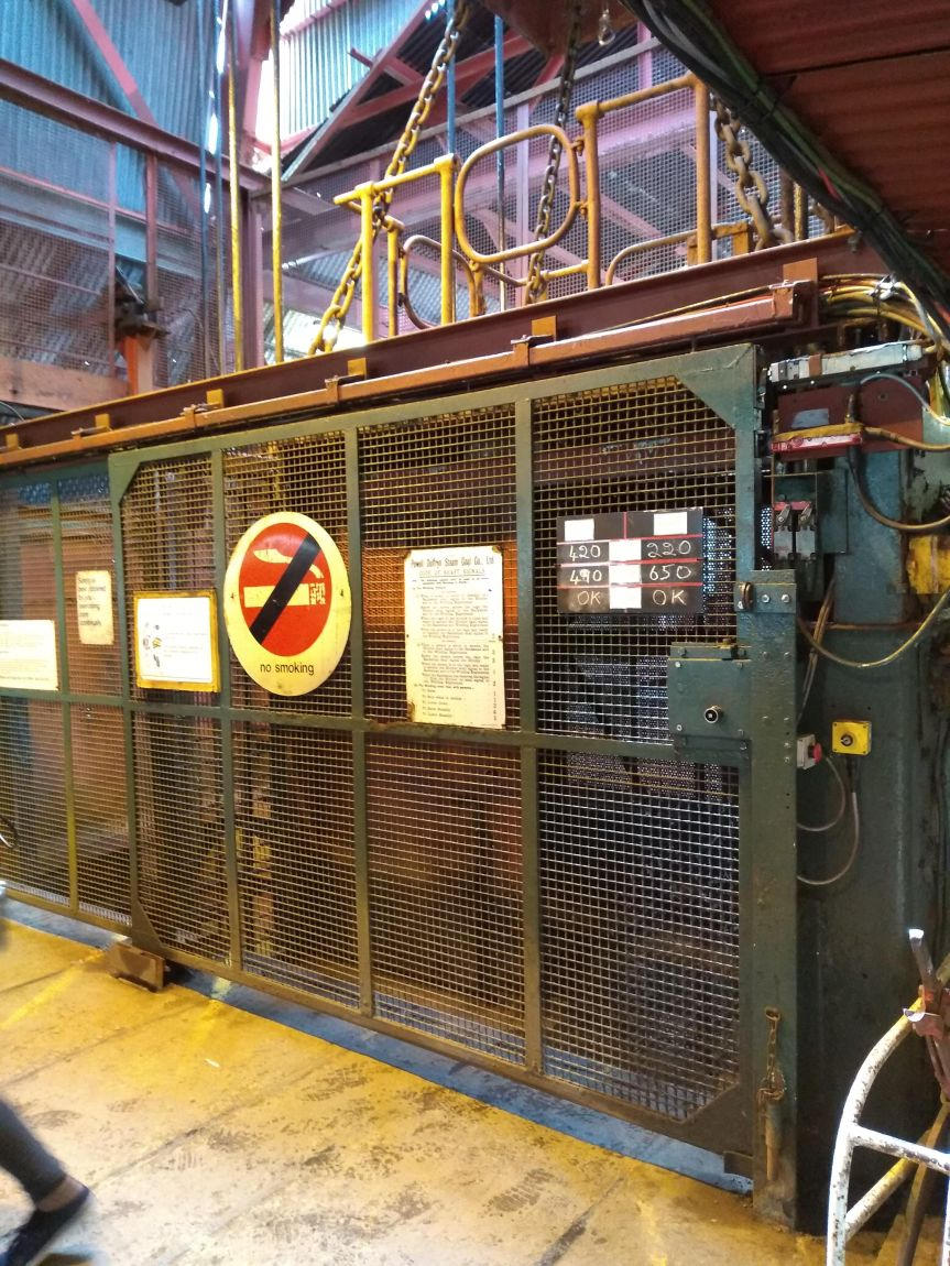 Mining elevator with a large No Smoking sign on it.